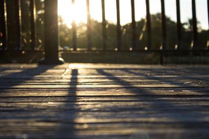 Sunset shining on a wooden deck