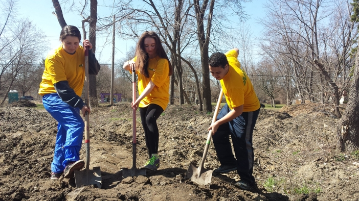 Three people digging with shovels for Urban Farming Volunteer Day