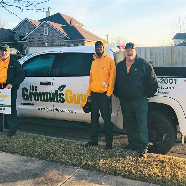 The Grounds Guys team in front of truck