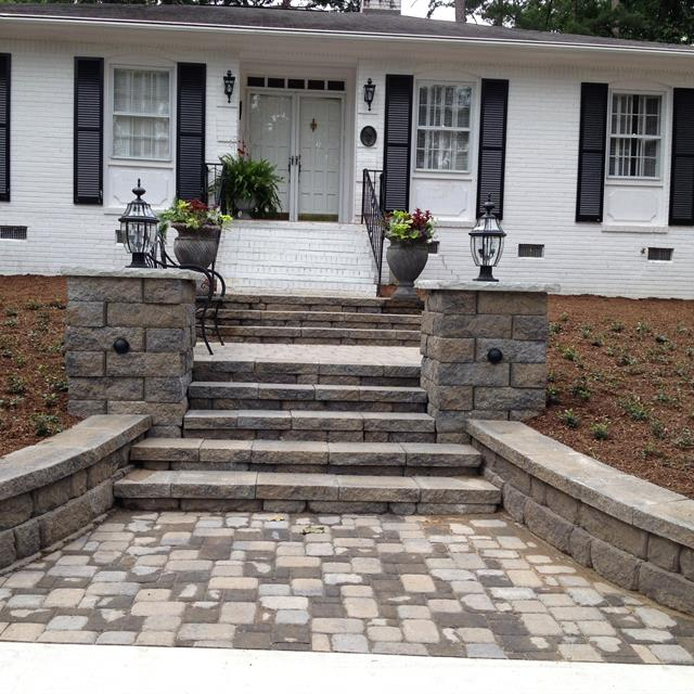 grey and neutral stone walkway with mulch landscaping