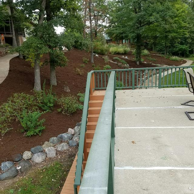 Concrete deck with steps and railing