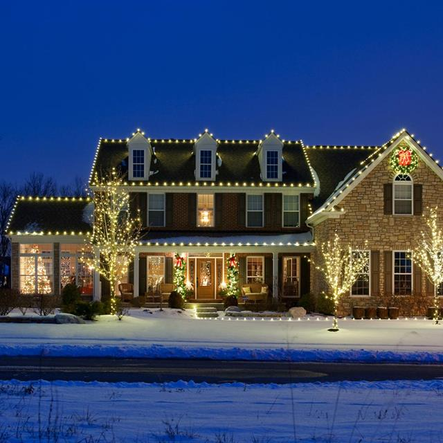 Front of house with holiday lighting