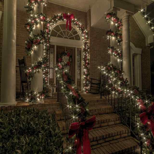 Side view of entry to house with holiday lighting