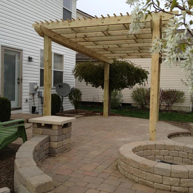 stone patio and wooden awning