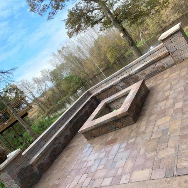 stone patio with square fireplace