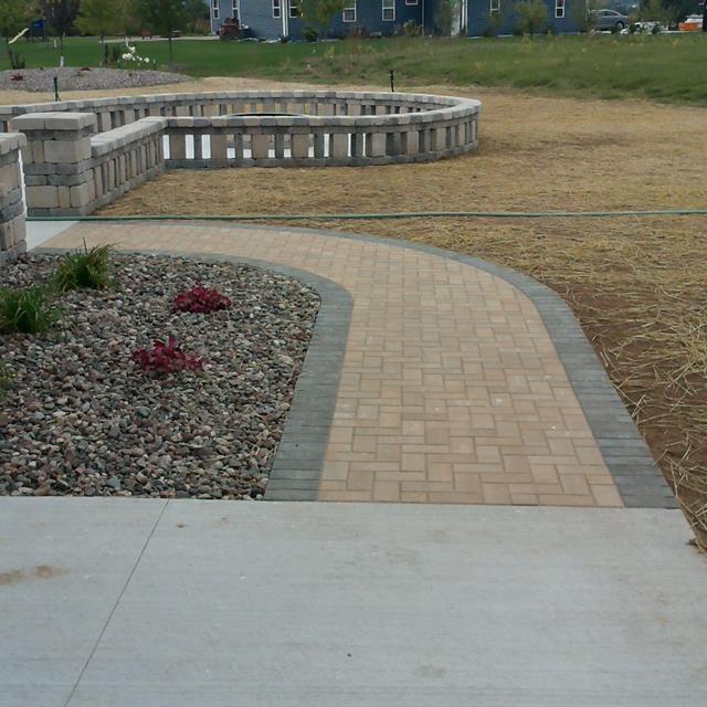 Brick path and gravel planter