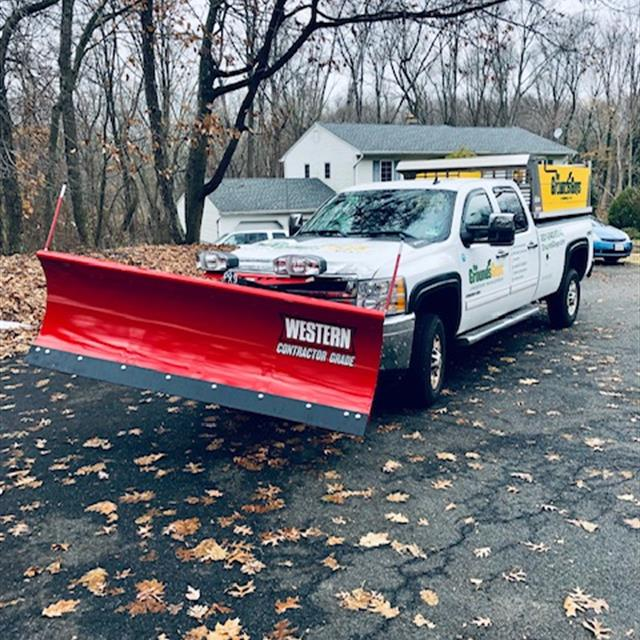 Grounds Guys truck and snow plow