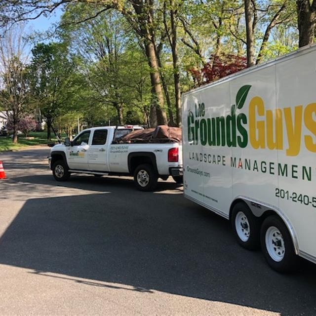 Grounds Guys truck and trailer
