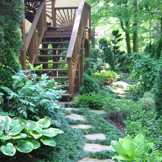 Stone path leading to wood stairs